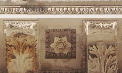 Modillions installed on architectural stone cornice