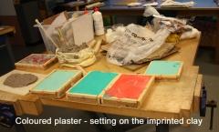 Coloured plaster setting on imprints